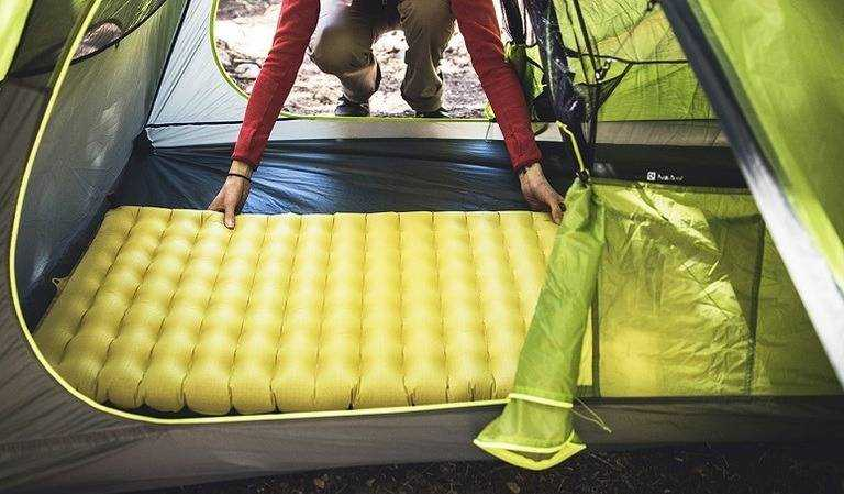 setting up sleeping pad in tent
